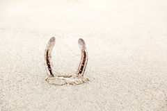 A horseshoe on the beach Stock Photos