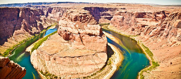 Horseshoe Bend in Colorado River. The Horseshoe Bend in the Colorado River is outside of Page, Arizona. It is a full hairpin turn in the massive river Royalty Free Stock Images