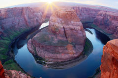 Horseshoe bend of Colorado river during sunset hours, Arizona, U Royalty Free Stock Photo