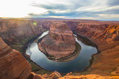 Horseshoe bend. Known as Horseshoe Bend, the Colorado River winds into a horseshoe, carving a path into the sandy red southwest desert of northern Arizona, near Stock Images