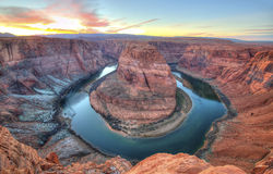 Horseshoe bend, page, arizona, united states. Winter sunset at Horseshoe Bend, Page, Arizona, United States. snow on the ground eroded red rock sandstone Royalty Free Stock Photo