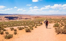 Horseshoe bend. Tour in Arizona. Tourists in the desert area of the Grand Canyon and the Colorado River. stock images