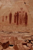 Horseshoe Canyon Great Gallery. Seven Barrier Canyon style ancient pictograph figures painted on sandstone cliff in Horshoe Canyon, Canyonlands National Park Royalty Free Stock Photography