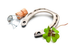 Horseshoe and champagne cork with a four leaf clover Stock Image