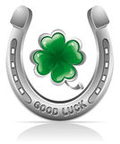 Horseshoe and clover. Horseshoe and four leaf clover - lucky symbol Stock Photos