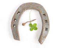 Horseshoe with clover Stock Images
