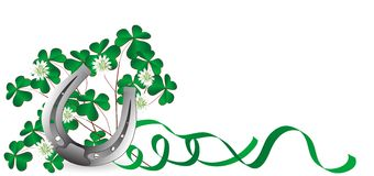 Horseshoe and clover. Silver horseshoe with clover leaves and ribbons Royalty Free Stock Images
