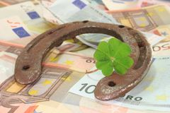 Horseshoe with clover and Euro Royalty Free Stock Images