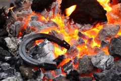 Horseshoe in the coals and flames Royalty Free Stock Photos