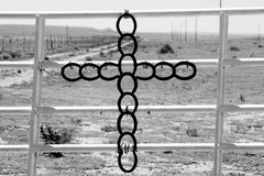 A horseshoe cross on a ranch gate in Kansas. Royalty Free Stock Photos