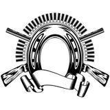 Horseshoe and crossed shotguns Royalty Free Stock Photography