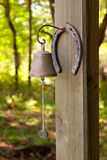 Horseshoe and Dinner Bell Royalty Free Stock Photography