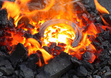 Horseshoe in embers Stock Images