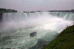 Horseshoe Falls with Maid in the Mist. The Horseshoe Falls, also known as the Canadian Falls, as most of it lies in Canada, is part of Niagara Falls, on the Stock Image