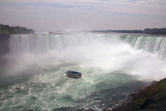 Horseshoe Falls with Maid in the Mist 2. The Horseshoe Falls, also known as the Canadian Falls, as most of it lies in Canada, is part of Niagara Falls, on the Royalty Free Stock Photo