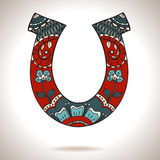 Horseshoe with floral ornament Royalty Free Stock Photos