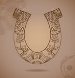 Horseshoe with floral ornament Stock Image