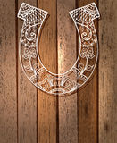 Horseshoe with floral ornament, lucky symbol Stock Photos