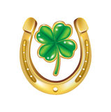 Horseshoe and four leaf clover Royalty Free Stock Photos