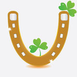 Horseshoe and four leaf clover. Stock Photo