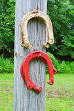 Horseshoe Game. Horseshoes hanging on a pole. Home made horseshoe game in backyard Royalty Free Stock Image