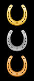 Horseshoe Gold Silver Bronze. Horseshoes - gold, silver, bronze - for first, second and third place Royalty Free Stock Photos