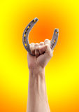 Horseshoe in hand Stock Images