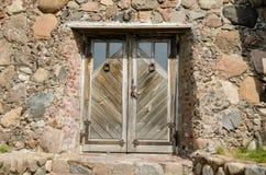 Horseshoe hang over stone wall wooden door Royalty Free Stock Image
