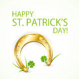 Horseshoe and a happy St Patricks Day Royalty Free Stock Images