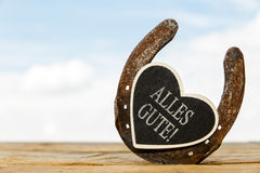 Horseshoe with heart and german text Stock Photo