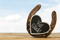 Horseshoe with heart and german text Royalty Free Stock Images