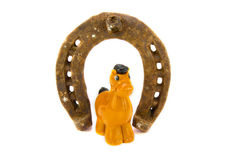 Horseshoe. And little horse toy Royalty Free Stock Photography
