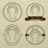 Horseshoe logos in different styles. With the inscription- your Stock Photography