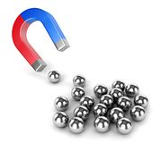 Horseshoe magnet and metal balls Royalty Free Stock Photos