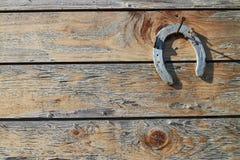 Horseshoe on nail on door Stock Images