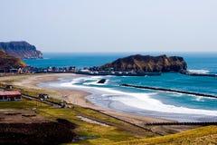 Horseshoe-shaped coast off Muroran, Hokkaido, Japan. Coastal view of Pacific Ocean from Muroran Youth Hostel Royalty Free Stock Image