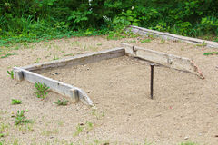 Horseshoe stakes in a sandbox area Royalty Free Stock Photos