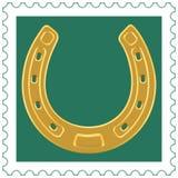 Horseshoe on stamp. Illustration of the gold horseshoe on postage stamp Stock Photo