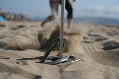 Horseshoe throw with sand spray. Horseshoe Throw with the sand spraying up Stock Photography