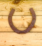 Horseshoe tree. Old rusty horseshoe horse nailed to wooden planks Stock Photo