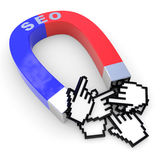 Horseshoe two color magnet attracts hand cursors. Royalty Free Stock Photography