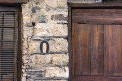 Horseshoe on the wall of house Royalty Free Stock Photo
