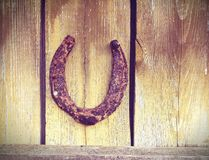 Horseshoe on the wall Royalty Free Stock Photos