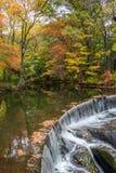 Horseshoe waterfall surrounded by fall foliage. At Hunts Mill Seekonk stock image