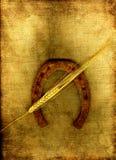 Horseshoe and wheat. Stock Images