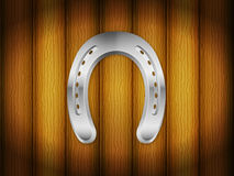 Horseshoe wood background Stock Images
