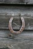 Horseshoe on wood Royalty Free Stock Images