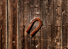 Horseshoe on wooden background Royalty Free Stock Photos