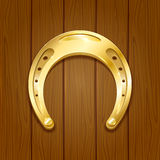Horseshoe on wooden background Royalty Free Stock Images