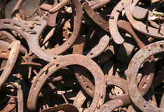 Horseshoes. Old rusty used horseshoes with the nails still in them Royalty Free Stock Photo